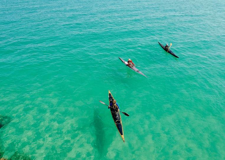 three-yellow-and-pink-kayak